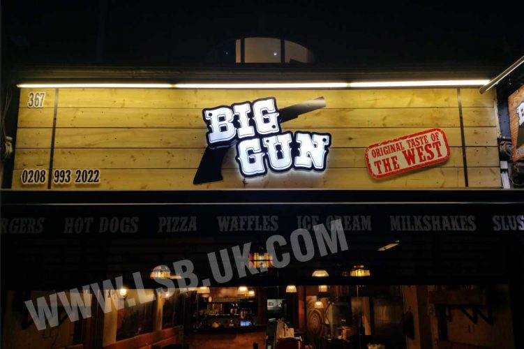 3D illuminated burger restaurant logo on Wood background sign board