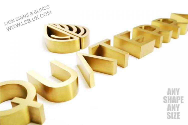 brushed gold internal sign london