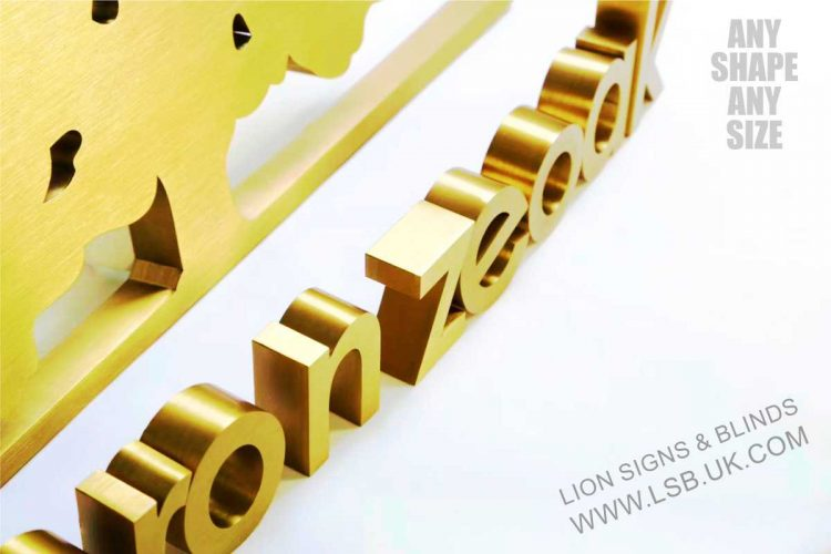 brushed gold stainless steel logo