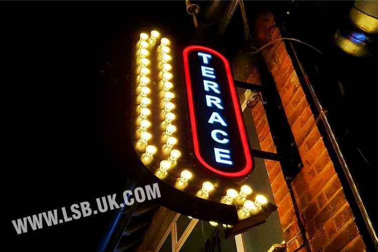 Double sided projection  sign with fairground light