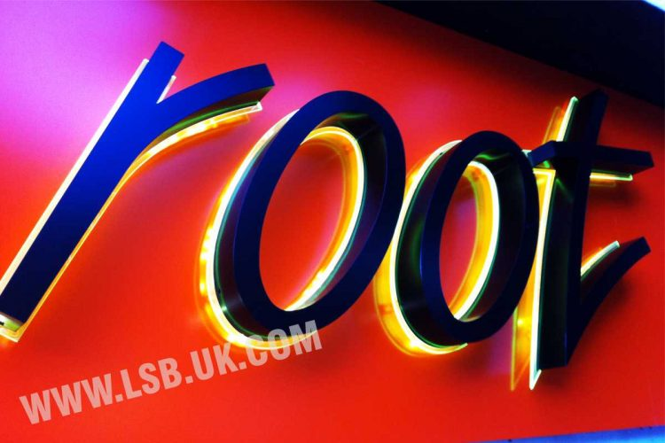 halo effect illuminated black and white aluminium 3d letters with neon acrylic