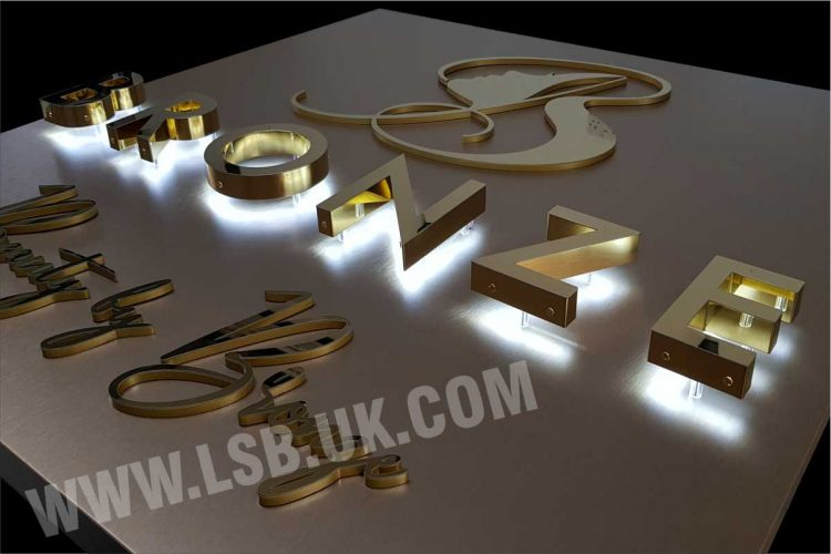 halo effect illuminated gold stainless steel letters with copper background