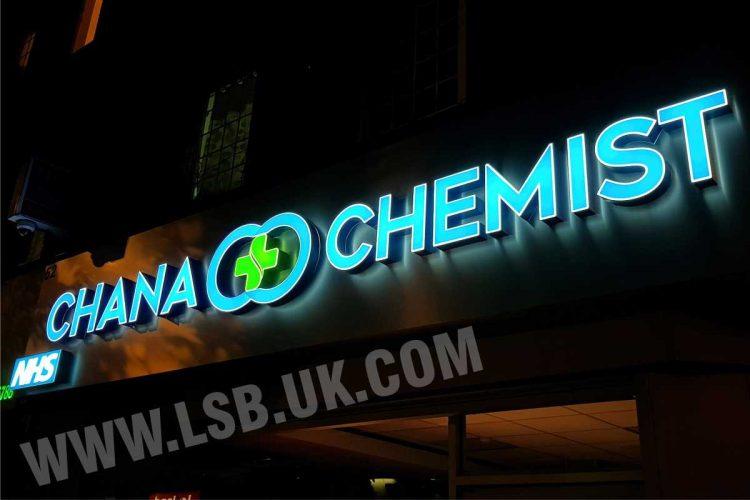 3D illuminated built up letters  chemist sign on aluminium tray background