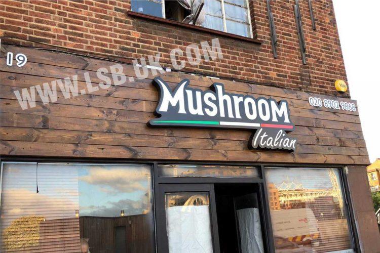 illuminated shop sign with wood background