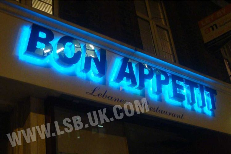 led Halo Illuminated mirror polished built up letters. Having blue halo effect