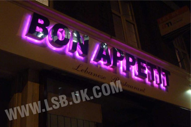 led Halo Illuminated mirror polished built up letters. Having purple halo effect