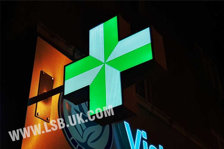 pharmacy cross projection sign