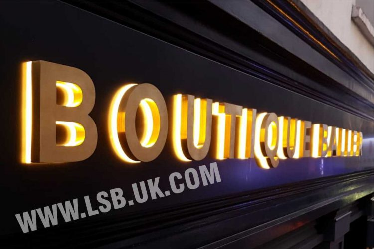 stainless steel gold built up letters with 20mm opal acrylic back