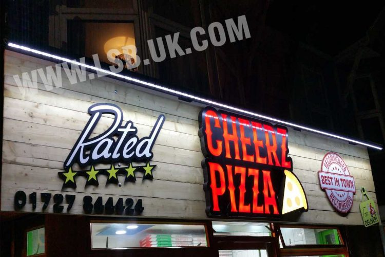 Wood background  with built up letters pizza shop sign board