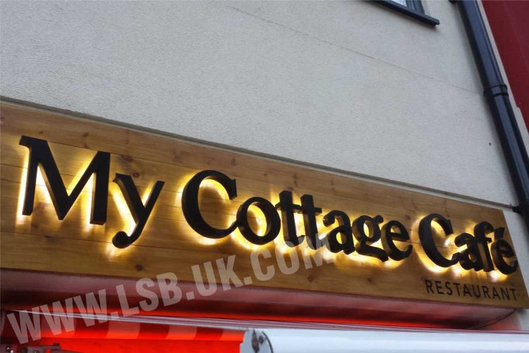 Wood timber background  with 3D built up letters with halo effect my cottage cafe