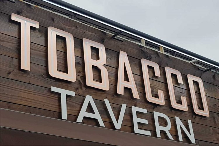 Copper letters on Timber background for tobacco shop