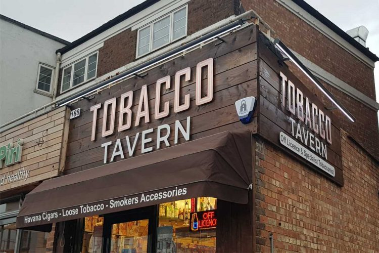 Timber background  copper letters tobacco sign